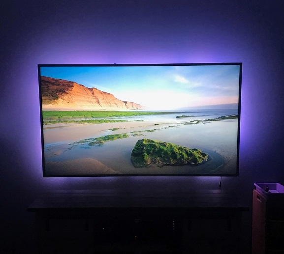 A living room television with a smart bias light installed. This bias light is integrated with the Amazon Echo products in this smart home.