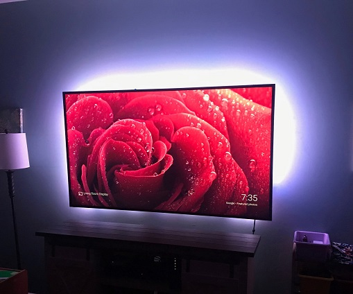 """A 65"""" living room television with bias lighting installed."""