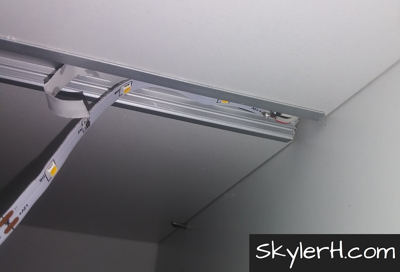 The start of the LED light strip adhered within the LED channel. When you upgrade your shelves with built-in LED lighting, make sure to center the LED strip lights in the channel for a professional look.