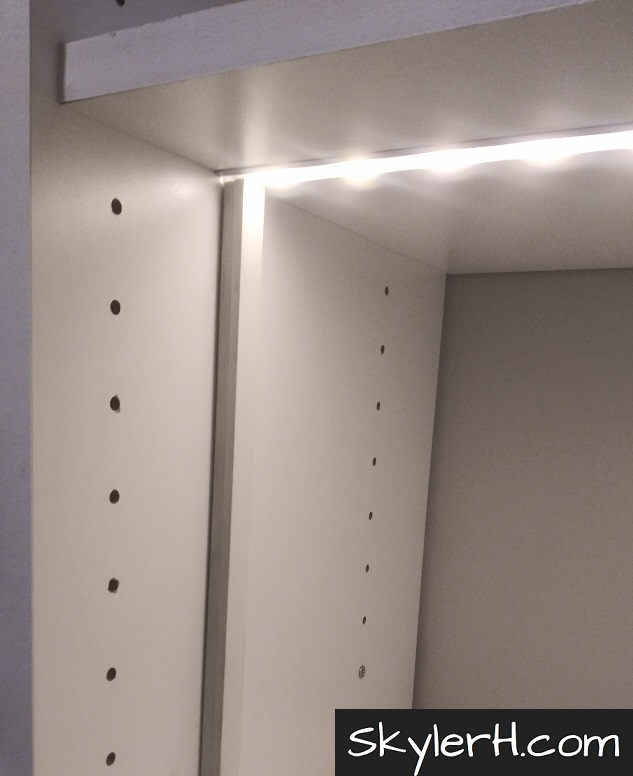 A vertical shelving element with cord concealer installed. The cord concealer hides low voltage wiring that is powering an illuminated LED light strip within built-in LED channel. Cord concealer of this type will help give your built-in LED lighting a finished look when you upgrade your shelves.